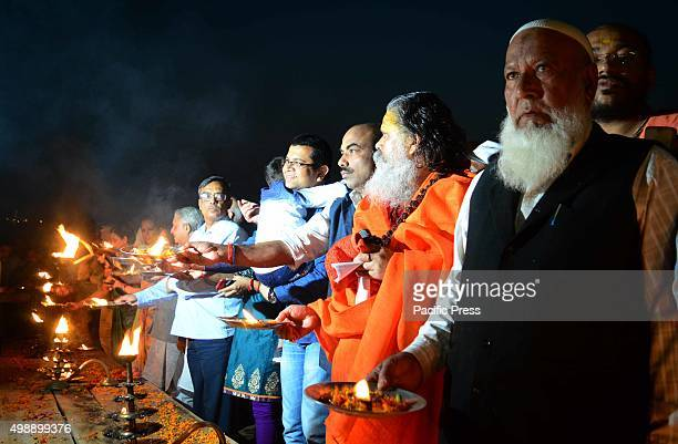 Hindu and Muslims lit oil lamps and perform aarti at Sangam the confluence of River Ganga Yamuna and mythological Saraswati on the occasion of dev...