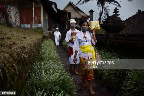 Hindu Balinese use maskers when they want to pray with some offerings in Besakih Temple Volcanic activity of Mount Agung has decreased in recent days...