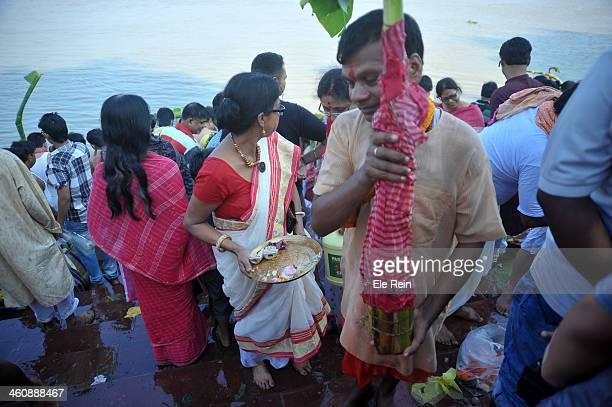 Hindu Bengali family at Ganga river bank Kolkata,India for holy bathing ritual of Banana tree, worshiped as wife of lord Ganesha,son of goddess Durga.