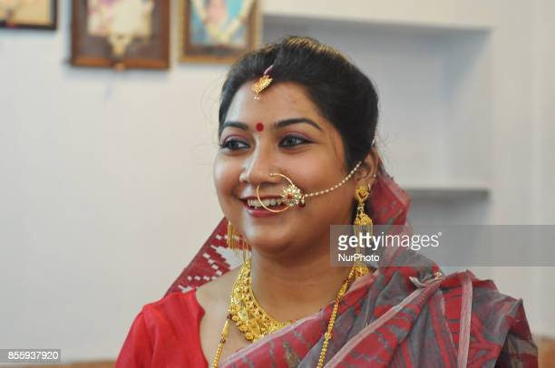 Hindu Bengali House Wife traditional dress during the idol of the Hindu goddess Durga on the last day of the Durga Puja festival in Kolkata India...