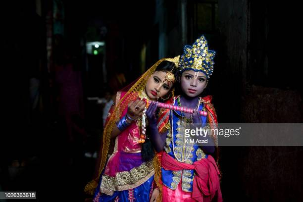 Hindu boy and girl poses for picture takes part in a procession during celebrations Janmashtami or Lord Krishnas Birthday in Dhaka Bangladesh...