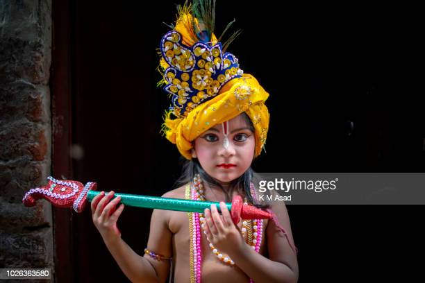 Hindu Boy poses for picture takes part in a procession during celebrations Janmashtami or Lord Krishnas Birthday in Dhaka Bangladesh According to...