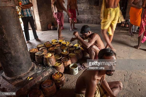Hindu brahmin priests cooking abhada or prasad for Lord Jagannath, a Hindu deity from Orissa, in a temple of Bhubaneswar, Orissa, India.