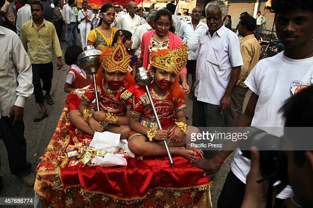 Hindu children dressed as a 'Monkey God Hanuman' participates in a procession as part of the Hindu festival of 'Hanuman Jayanti' at Allahabad Hanuman...
