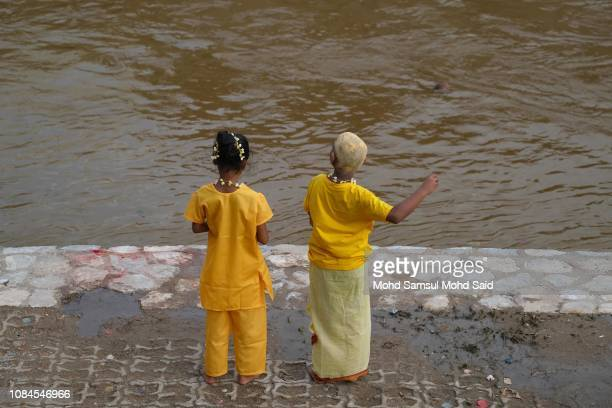Hindu children play near the river before start of a pilgrimage to the sacred Batu Caves temple during the Thaipusam festival on January 18 2019...