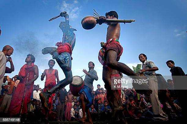 Hindu community devotees perform dance as they celebrate the rituals of Charak Puja also known as Nil Puja in Sylhet Bangladesh April 13 2012 Charak...