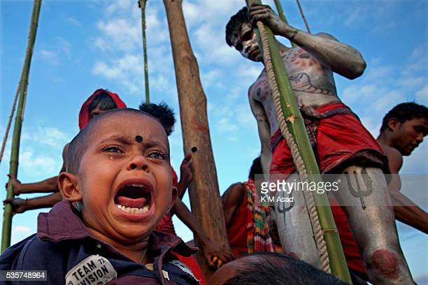 Hindu community devotees perform to celebrate the rituals of Charak Puja also known as Nil Puja in Sylhet Bangladesh April 13 2012 Charak Puja is an...