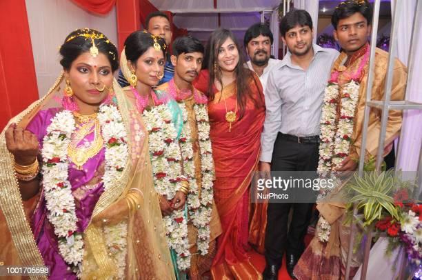 Hindu couples along Vaishali Dalmiya MLA and Abhishek Dalmiya at the mass wedding ceremony organized by Board of Control for Cricket in India's...