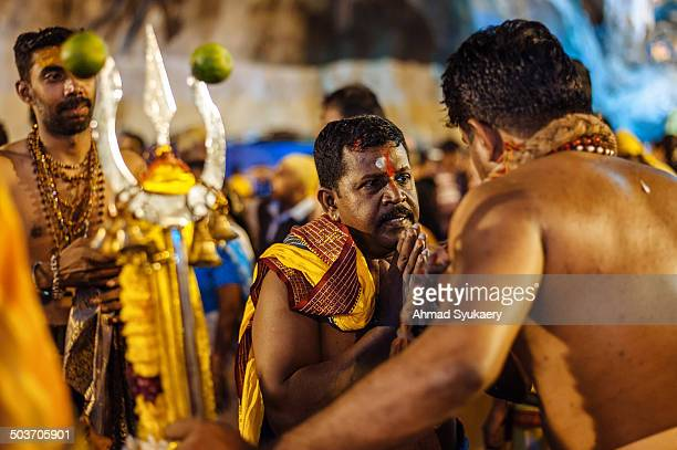 Hindu devotee asks for blessing during Thaipusam festival at Batu Caves temple Malaysia