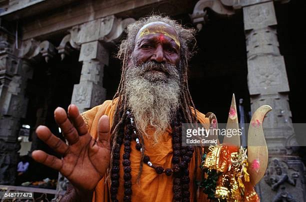 A Hindu devotee at the ruins of the city of Vijayanagara the former capital of the ancient Vijayanagara Empire in Hampi northern state of Karnataka...