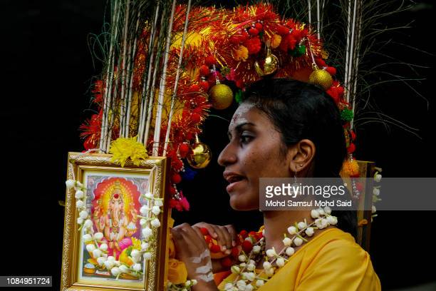 Hindu devotee carries a kavadi before her pilgrimage to the sacred Batu Caves temple during Thaipusam festivals on January 19 2019 outside Kuala...