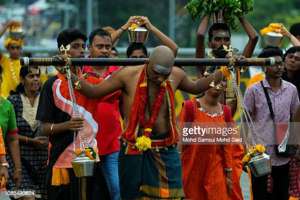 Hindu devotee carries a pot with milk on his body during pilgrimage to the sacred Batu Caves temple during Thaipusam festivals on January 20 2019...