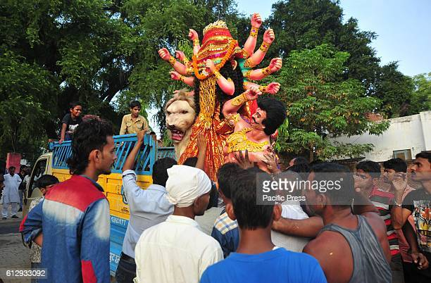 Hindu Devotee carrying Goddess Durga idol during Dussehra Festival celebration Dusshera or Vijayadashmi as it is popularly known as is a major Hindu...