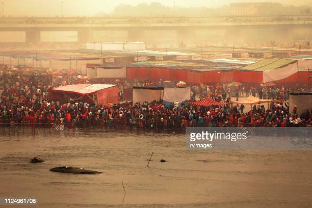 hindu devotee celebrating chhath pooja festival during winter foggy day - chhath festival stock pictures, royalty-free photos & images