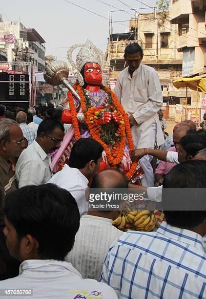 Hindu devotee dressed as a 'Monkey God Hanuman' participates in a procession as part of the Hindu festival of 'Hanuman Jayanti' at Allahabad Hanuman...