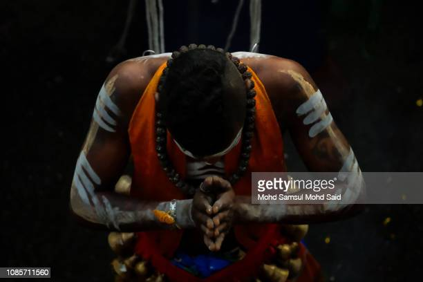 Hindu devotee perform a prayer at Batu Caves temple during Thaipusam festivals on January 21 2019 outside Kuala Lumpur Malaysia Thaipusam is a Hindu...