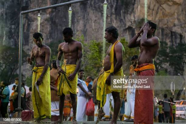 Hindu devotee perform a ritual bath near the river before their pilgrimage to the sacred Batu Caves temple during Thaipusam festivals on January 20...