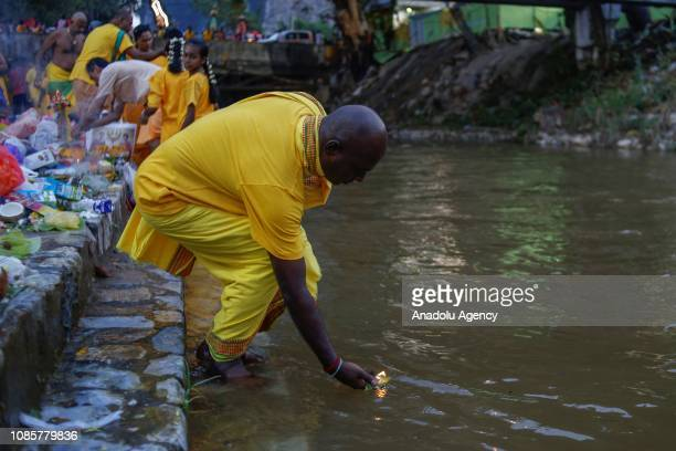 Hindu devotee performs a ritual at the bank of river prior to walking up to the Batu Caves Temple during the festival of Thaipusam in Kuala Lumpur...