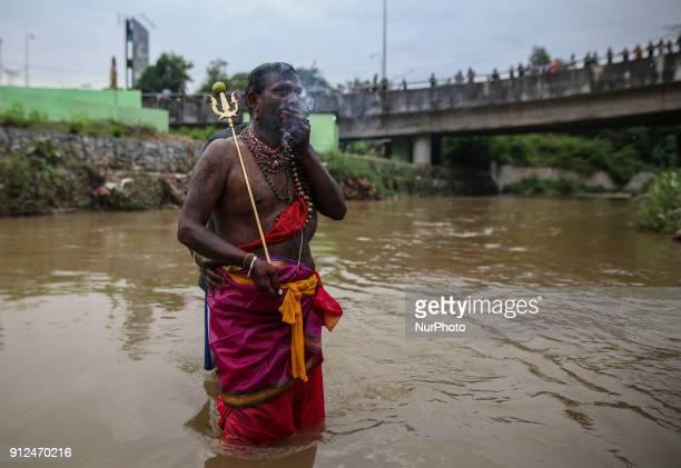 A hindu devotee prays before making his way towards the Batu Caves temple during the Thaipusam Hindu festival on January 31 2018 in Batu Caves...