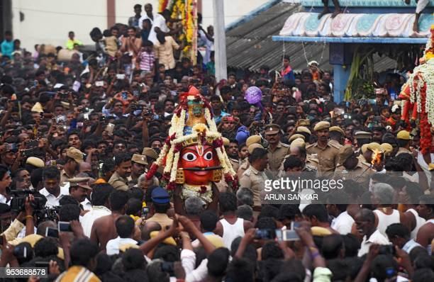 Hindu devotees and transgenders devotees take part in a ritual procession of the statue of warrior god Aravan the day after a ritual marriage...