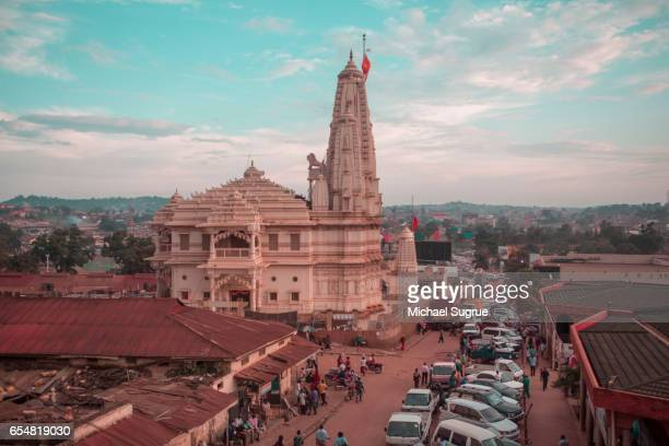 hindu devotees approach the shree sanatan dharma mandal temple in kampala, uganda at dawn. - kampala stock pictures, royalty-free photos & images