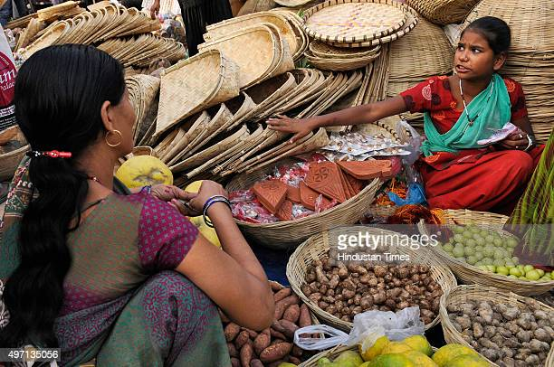 Hindu devotees are out for shopping ahead of the upcoming Chhath Puja festival at a market, on November 14, 2015 in Noida, India. The Chhath...
