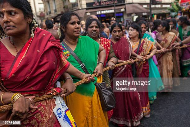 CONTENT] Hindu devotees are pulling the rope of a chariot at Ganesha held on September 1st 2013 Paris France