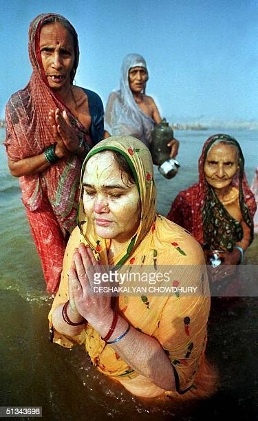 Hindu devotees bath in the waters where the Ganges, the Yamuna and the mythical Saraswati rivers converge in Allahabad, 09 January 2001. Thousands of...