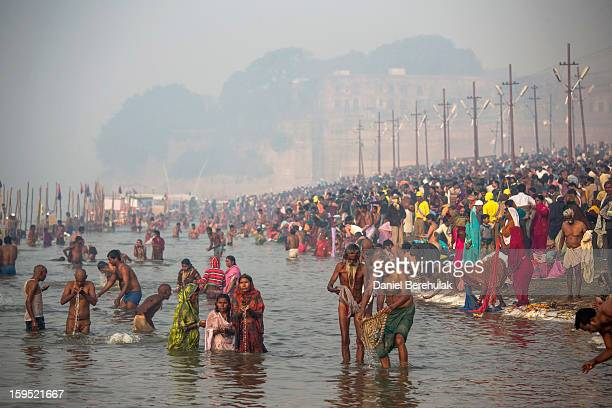 Hindu devotees bathe in the waters of Sangam, the confluence of the holy rivers Ganges, Yamuna and the mythical Saraswati, during the Maha Kumbh Mela...
