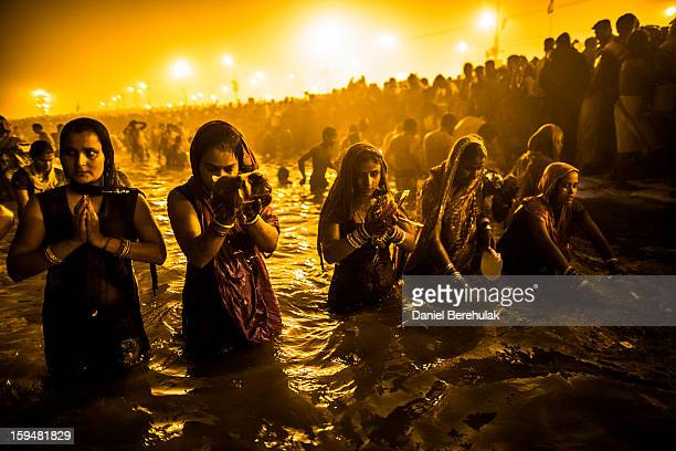Hindu devotees bathe in the waters of the holy Ganges river during the auspicious royal bathing day of Makar Sankranti the start of the Maha Kumbh...