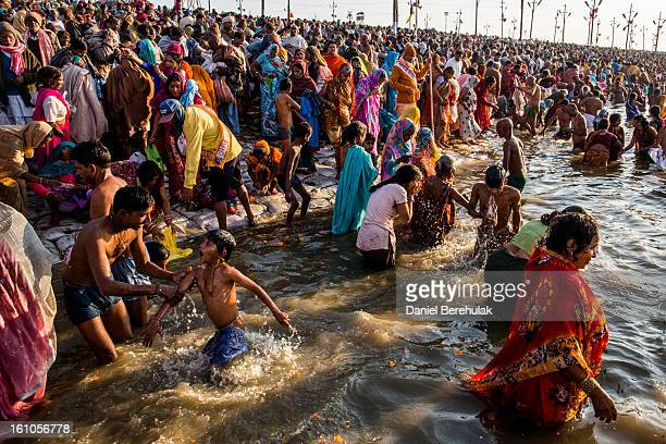 Hindu devotees bathe on the banks of Sangam, the confluence of the holy rivers Ganges, Yamuna and the mythical Saraswati, during the Maha Kumbh Mela...