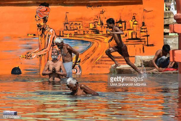 Hindu devotees bathe on the occasion of Akshaya Tritiya, a annual spring festival which is believed to bring good luck and success, during a...