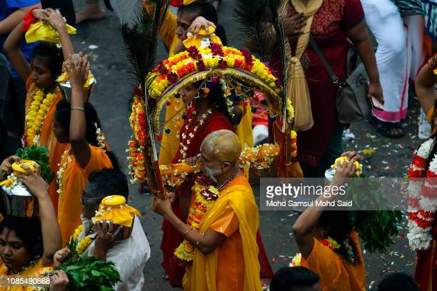 Hindu devotees carries a kavadi on her body during a pilgrimage to the sacred Batu Caves temple during Thaipusam festivals on January 20 2019 outside...