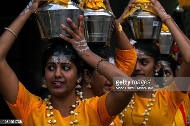 Hindu devotees carries a pot with milk on her heads before their pilgrimage to the sacred Batu Caves temple during Thaipusam festivals on January 19...