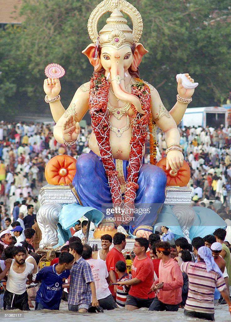 Hindu devotees carry a big clay idol