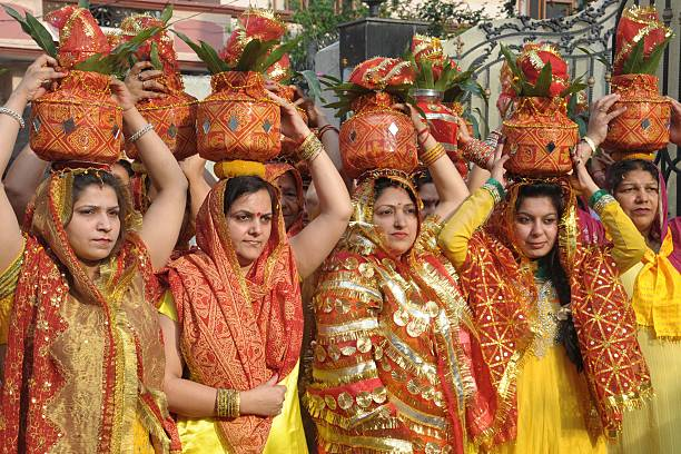 Hindu devotees carry earthen pots containing coconuts and water as they take part in a `Kalash Yatra` religious procession in Amritsar on April 13...