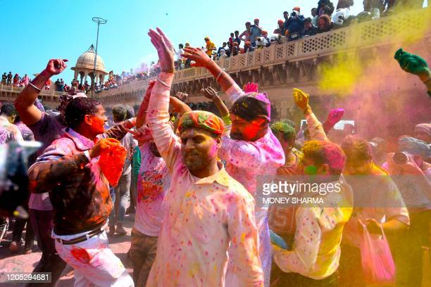 Hindu devotees celebrate Holi the spring festival of colours during a traditional gathering at a temple in Nandgaon village in Uttar Pradesh state on...