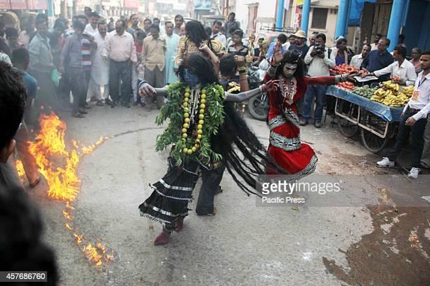 Hindu devotees dressed as a Maa Kali participates in a procession as part of the Hindu festival of 'Hanuman Jayanti' at Allahabad Hanuman Jayanti...