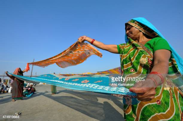 Hindu devotees dry saris in the wind at the Sangam the confluence of Ganges Yamuna and mythical Saraswati rivers during Maha Kumbh Mela