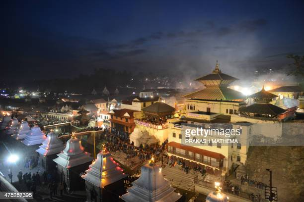 Hindu devotees gather at dusk at the Pashupatinath temple during the Maha Shivaratri festival in Kathmandu on February 27 2014 Hindus mark the Maha...