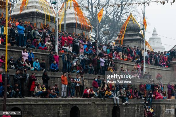 Hindu devotees gather by the Bagmati river at the Pashupatinath temple complex one of the holiest shrines of the Hindus as well as UNESCO Heritage...