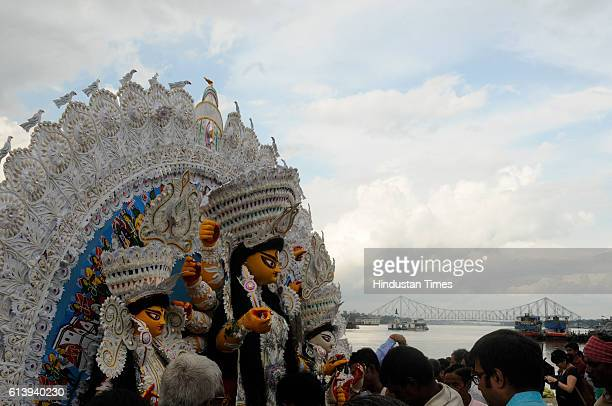 Hindu devotees gather in numbers on the banks of river for the immersion of Goddess Durga as part of the Durga Puja festival on October 11 2016 in...