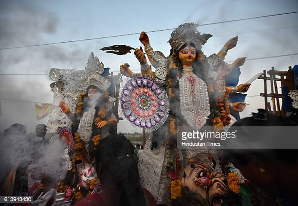 Hindu devotees gather in numbers on the banks of River Yamuna for the immersion of Goddess Durga as part of the Durga Puja festival on October 11...