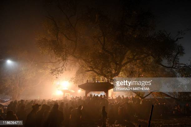 Hindu devotees gather near a temple during the Gadhimai Festival in Bariyarpur 160 kms south of the capital Kathmandu on December 3 2019 The stench...