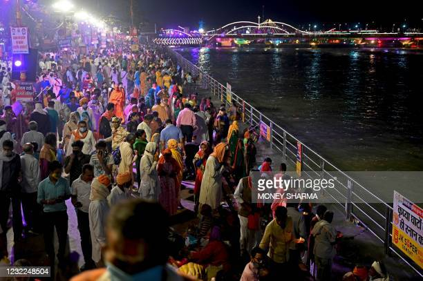 Hindu devotees gather on the banks of Ganges River during the ongoing religious Kumbh Mela festival in Haridwar on April 11, 2021.