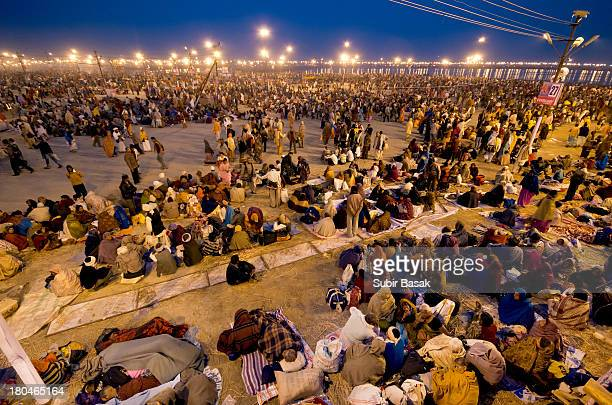 CONTENT] Hindu devotees gather themselves on the banks of Sangam the confluence of the holy rivers Ganges Yamuna and the mythical Saraswati during...