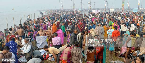 Hindu devotees gather to bath in the Sangam river confluence during Panchami Magh Mela religious fair in Allahabad. Thousands of devotees bath as it...