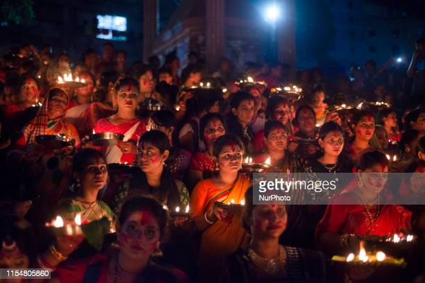 Hindu devotees gathered beside river Buriganga to float their lamps just after offering Bipodtarani puja at Dhaka Bangladesh on July 9 2019