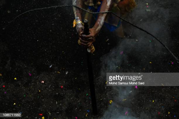 Hindu devotees hits his hand with rope as he perform a prayer at Batu Caves temple during Thaipusam festivals on January 21 2019 outside Kuala Lumpur...