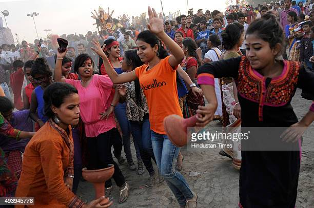 Hindu devotees immerse the idol of Goddess Durga on the final day of the Durga Puja celebrations on October 23 2015 in Noida India Durga Puja...